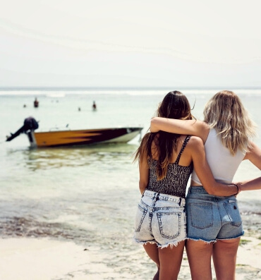 Girls in Bali looking out at ocean and boat, Ocean Soul Women's Wellness Retreat in Seminyak, Bali
