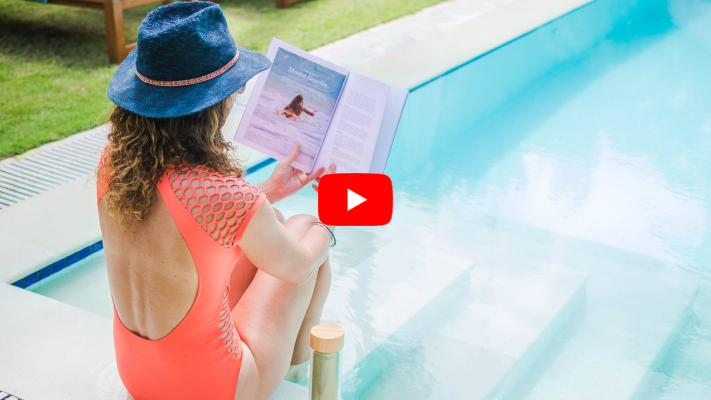 Video testimonial, Woman sitting and relaxing by pool reading